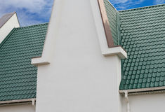 House with a green brick. On background sky Stock Photos