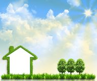 House on green field Royalty Free Stock Images