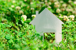 House in green field Royalty Free Stock Photography
