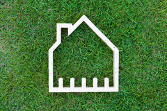 House in green field, house icon concept Stock Images