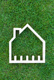 House in green field, house icon concept Stock Image