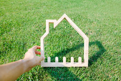 House in green field, house icon concept Royalty Free Stock Photography