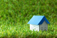 House on green field Royalty Free Stock Photography