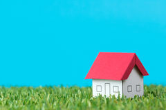 House on green field Stock Images