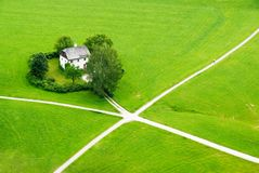 House in the green field of Saltzburg Stock Photos