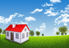 House on green field under blue sky. House green field under blue sky with white clouds, nature background Stock Photography