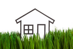 House and green grass Stock Photography