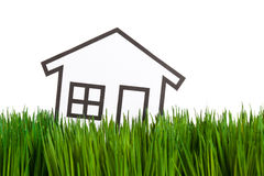 House and green grass Stock Images