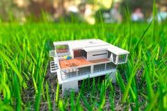 House on the green grass Stock Photos