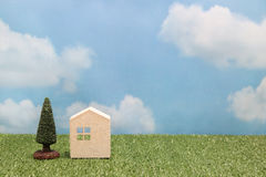 House on green grass over blue sky and clouds. Mortgage concept Royalty Free Stock Photography