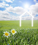 House on a green landscape Stock Image