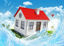 House, green meadow and water splash Stock Photography