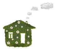 House from green moss with clouds Stock Image
