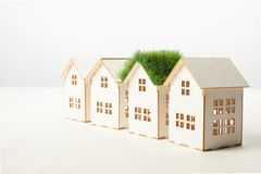 House with green roof in among white houses Stock Photography
