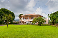 House in Grenada. St. George's, Grenada - December 3, 2011: Luxury mansion in exclusive part of St. Georges, Grenada at December 3, 2011 Stock Photos