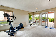 House gym room with exit to backyard Stock Image