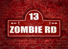 House halloween nameplate. Vintage styled house nameplate. Zombie silhouettes. 13 number and zombie rd text. Ancient brick wall grunge texture Royalty Free Stock Image