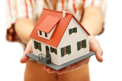 House in hand. Model house in woman's hand Royalty Free Stock Photos
