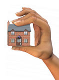 House In Hand. 3D illustration of a house held in hand, isolated on white background Royalty Free Stock Image
