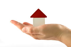 House on hand. Woman holds house of blocks. new house concept Royalty Free Stock Photos