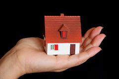 House in hand. Image of house with red roof in hand Royalty Free Stock Photos