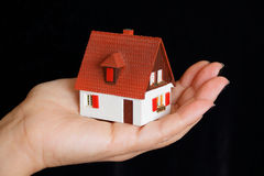 House in hand. Image of house with red roof in hand Stock Image
