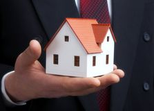 The house in a hand Royalty Free Stock Photos