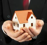 The house in a hand Stock Photos
