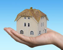 House in hand. Little house in woman hand Royalty Free Stock Photos
