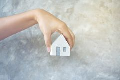 House in hand close-up.on bright background stock image