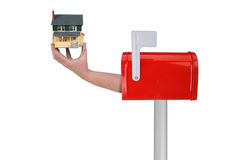 House in hand coming out of mailbox Royalty Free Stock Photo