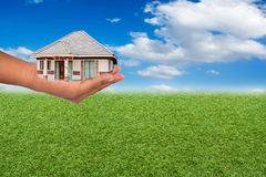House in hand. Investment concept about the property Royalty Free Stock Photography