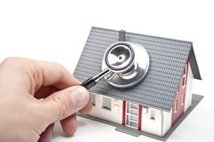 House with hand and stethoscope stock image