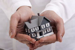 House in Hands Stock Photography