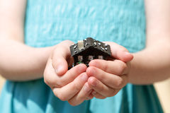 House In Hands. Feminine child holding house Royalty Free Stock Images