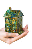 House in hands. Small earthenware house in woman hands isolated on white background royalty free stock images
