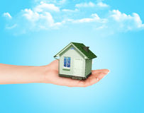 The house in hands. On blue sky Royalty Free Stock Image