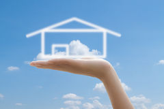 House in  hands and blue sky Stock Image