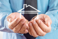 House in hands of businessman Stock Photography