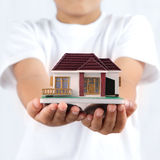 House in hands Stock Image