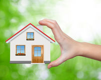 The house in hands. On green natural backgorund Royalty Free Stock Photo