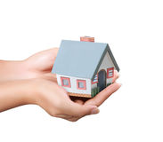 House in hands. Holding house representing home ownership and the Real Estate business Royalty Free Stock Photo