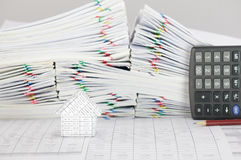 House have blur brown pencil with calculator place vertical. House on finance account have blur brown pencil with calculator place vertical and pile overload royalty free stock photo