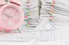 House have blur old pink alarm clock and pile paperwork Royalty Free Stock Photos