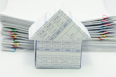 House have pile overload document of report. With colorful paperclip as background Royalty Free Stock Image