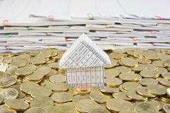 House in heap of gold coins Royalty Free Stock Photo