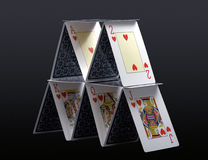 House of Hearts. House of cards isolated against grey background with clipping path Stock Photos