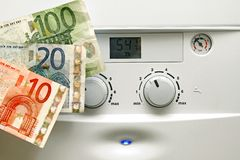 House heating boiler and euro money Stock Images
