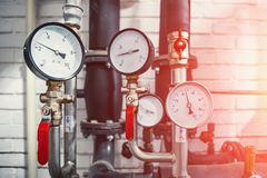 House heating system with many steel pipes, manometers and metal tubes royalty free stock image