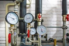House heating system with many steel pipes, manometers and metal tubes stock image